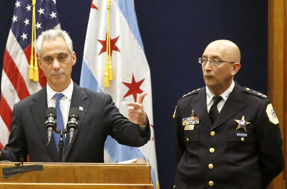 Chicago Mayor Rahm Emanuel, accompanied by Interim Chicago Police Superintendent John Escalante, speaks during a news conference in Chicago on Dec. 7.