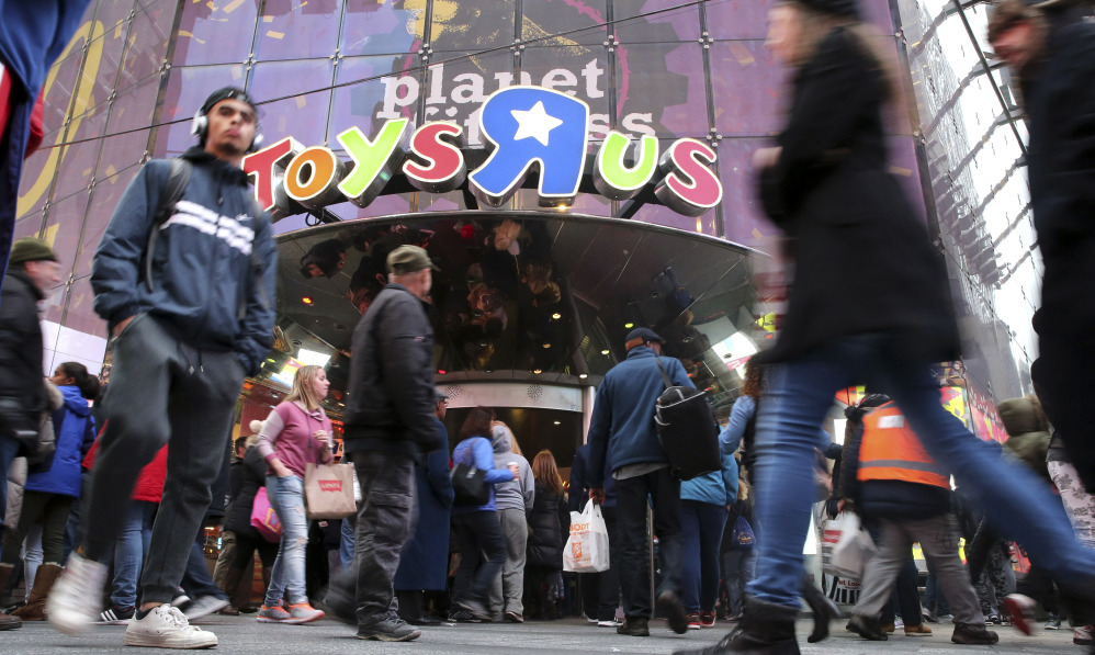 Fourteen years after it began wowing millions of tourists with its indoor 60-foot Ferris wheel and a growling 20-foot Tyrannosaurus, the giant Toys R Us flagship store in New York's Times Square closed its doors Wednesday.