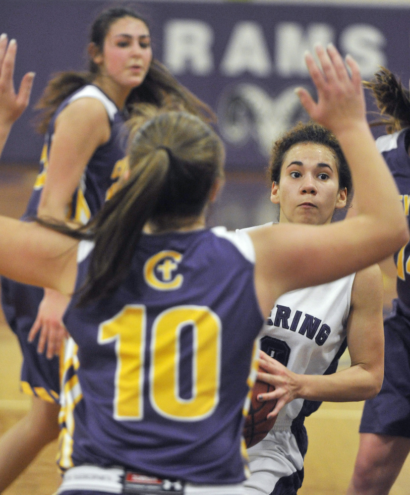 Abby Ramirez, who scored 15 points Wednesday for Deering, looks to penetrate while guarded by Ally Tillotson of Cheverus. Deering won, 59-42.