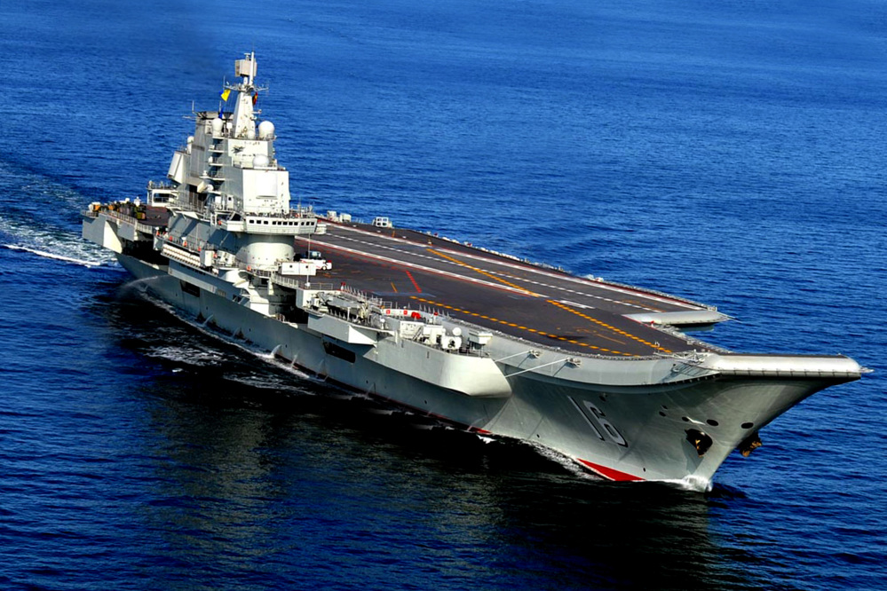 The Liaoning, China's first aircraft carrier, sails in the sea near Qingdao in eastern China's Shandong province. China's Defense Ministry spokesman Col. Yang Yujun told reporters at a news conference Thursday that China is building a second aircraft carrier, this time entirely with domestic technology.
