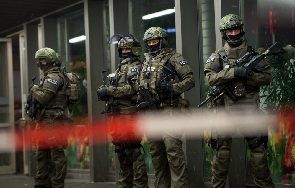 "German special police stand in front of Munich's main train station Thursday evening after police warned of an ""imminent threat"" of a terror attack and ordered two train stations cleared."