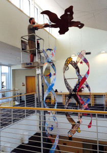 "Neil Bruns installs ""All Life Interrelated,"" a sculpture by Kate Cheney Chappell, at Kingswood Oxford School in West Hartford, Conn. (Photo courtesy of Kate Cheney Chappell)"