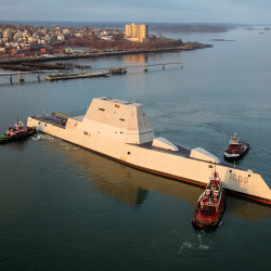 In this December 10, 2015 file photo, the Zumwalt is turned by tugboats in Portland Harbor. Photo by Dave Cleaveland Maineimaging.com