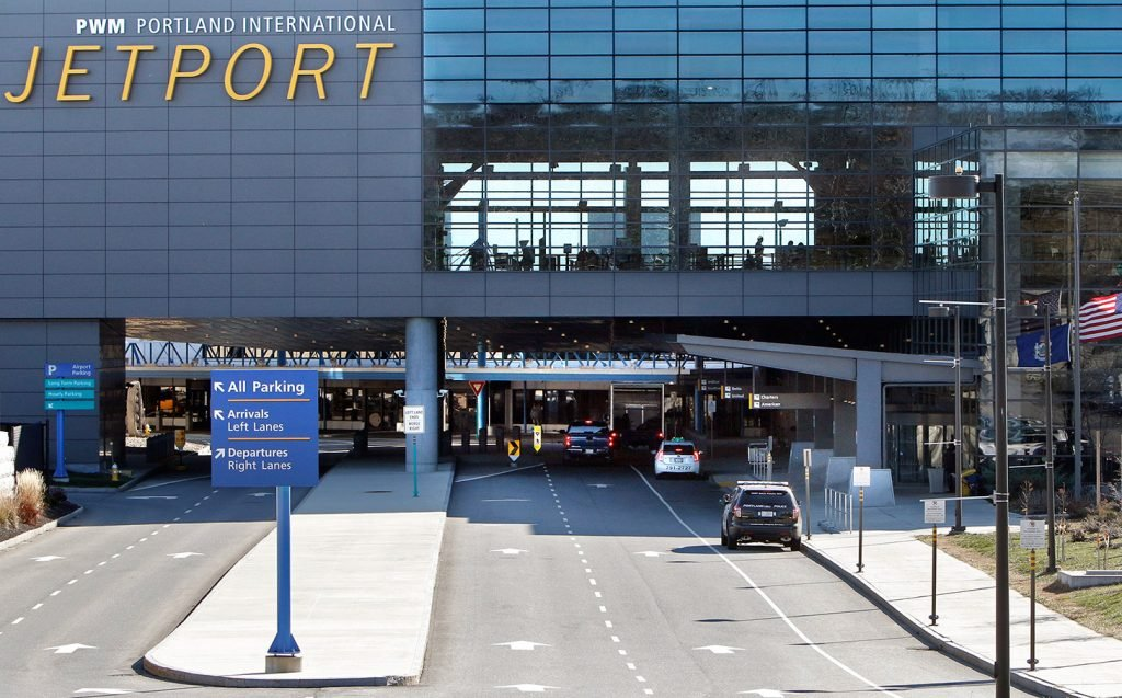 A car fire in a parking garage at the Portland International Jetport briefly closed the garage and loop road Tuesday.