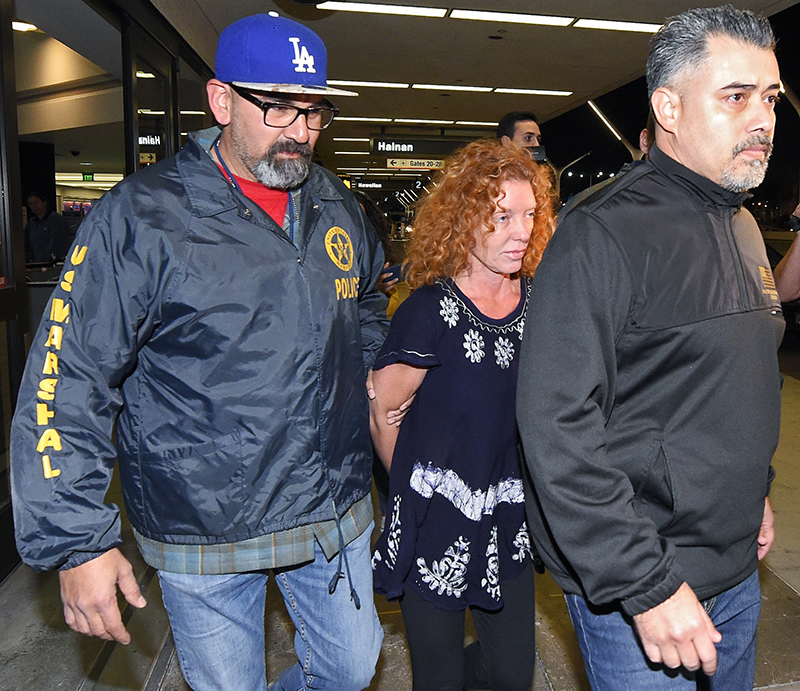 Tonya Couch, center, is taken by authorities to a waiting car after arriving at Los Angeles International Airport from Mexico on Thursday.