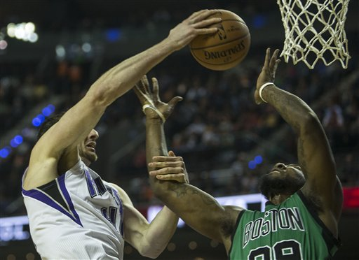 Kings center Kosta Koufos blocks Celtics forward Jae Crowder in the first half in Mexico City on Thursday. The Associated Press