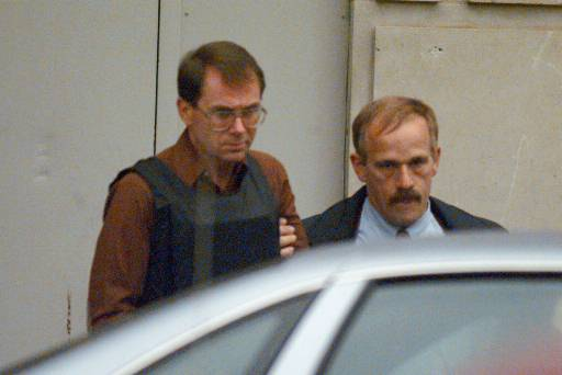 Wearing a bullet-proof vest, Terry Nichols is led by a U.S. marshal from the federal courthouse in Wichita, Kan., on April 26, 1995.