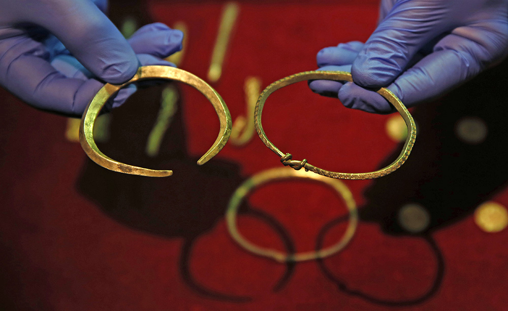 A closeup of some of the jewelry and ingots of a significant Viking hoard found near Watlington, in Oxfordshire, England, on display at the British Museum in London. The Associated Press