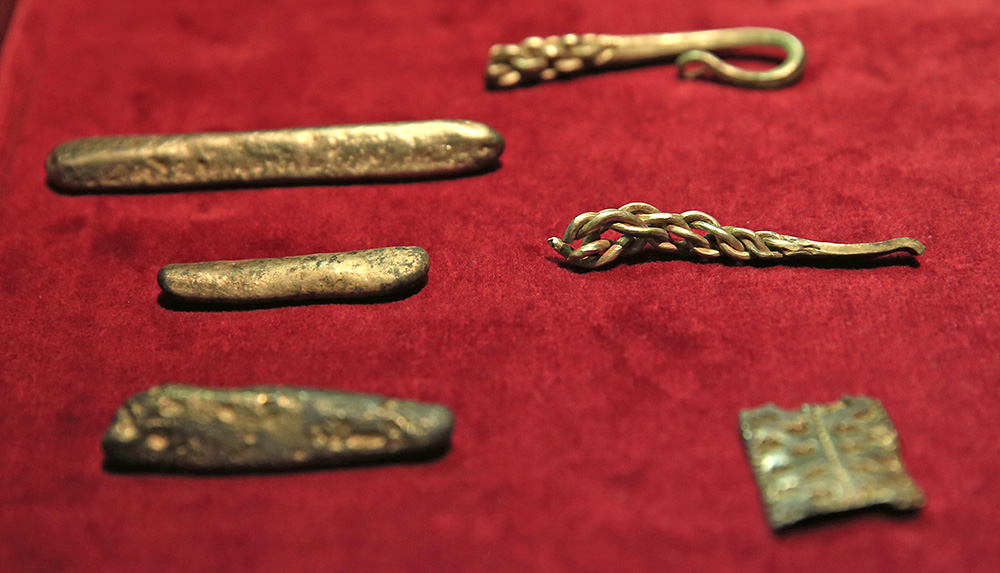 The hoard contains 186 coins, seven items of jewelry and 15 ingots of gold and silver. The Associated Press