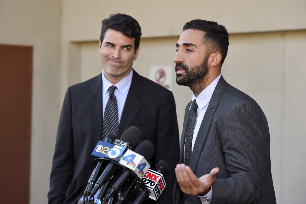 David Chesley, left, and Mohammad Abuershaid, attorneys for the family of Syed Farook, speak to reporters Friday in Los Angeles. They said Farook's mother, who lived with him and his wife, never saw any of the weapons or bombs that authorities found. The Associated Press