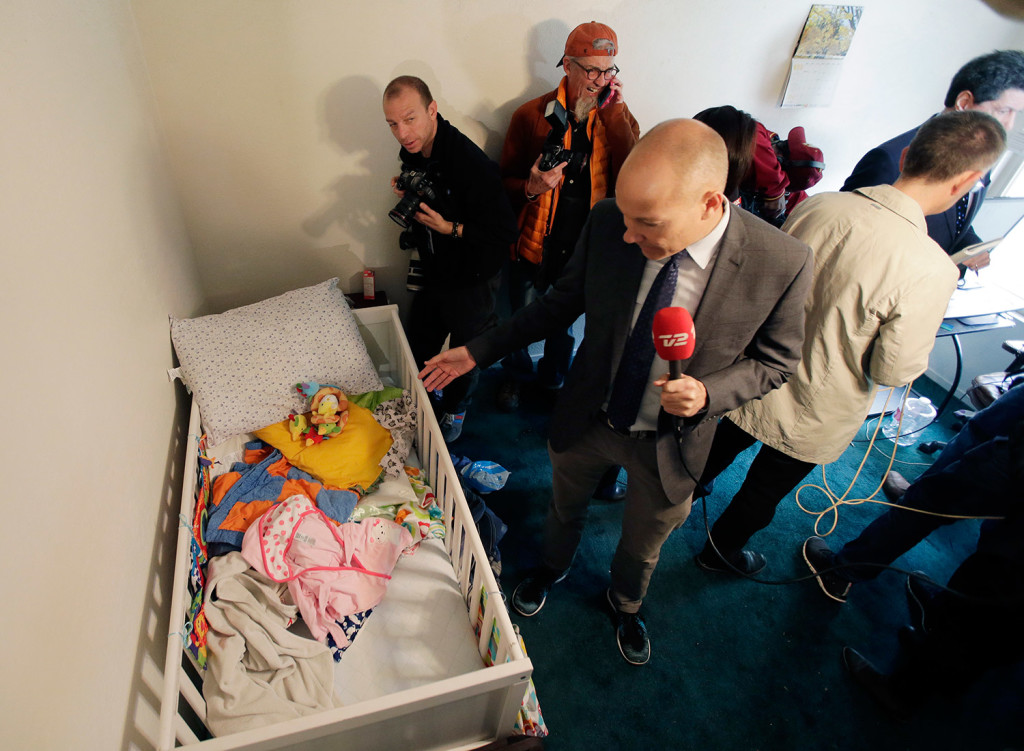 Members of the media crowd into a child's room in the apartment where Syed Farook and Tashfeen Malik lived. Live broadcasts from the apartment Friday drew criticism. The Associated Press