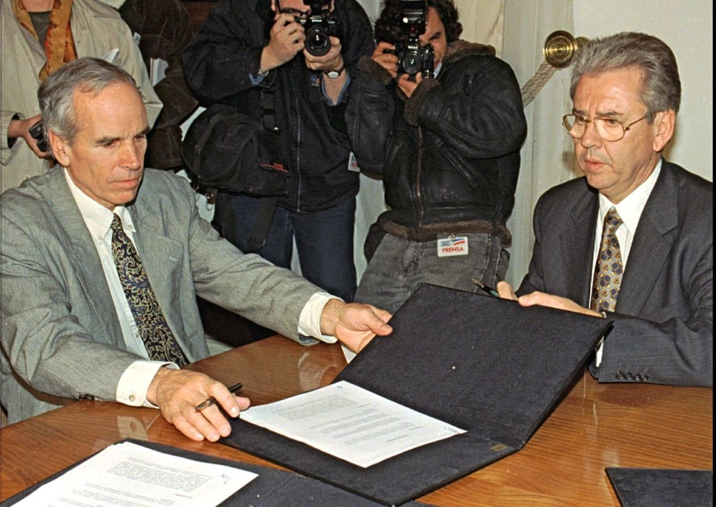 American millionaire Douglas Tompkins, left, and Juan Villarzu, chief of staff of the Chilean president, hold the text of an accord signed in Santiago, Chile, in this this July 7, 1997, photo. The Associated Press