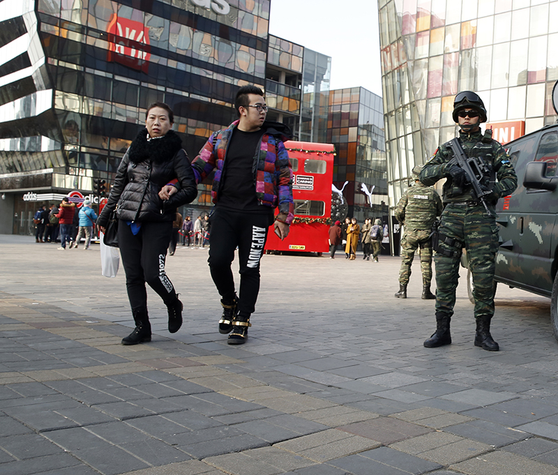 Heavily armed Chinese paramilitary police guard a popular mall in the Sanlitun district of Beijing, China. Increased security could be seen in the area as the U.S. and British embassies in the Chinese capital issued travel alerts regarding the possible threats against westerners.