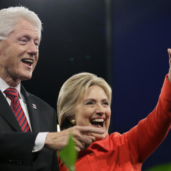 Democratic presidential candidate Hillary Clinton and her husband, seen last year in Iowa, paid an effective tax rate of 34.2 percent in 2015, her campaign says. Associated Press/Charlie Neibergall