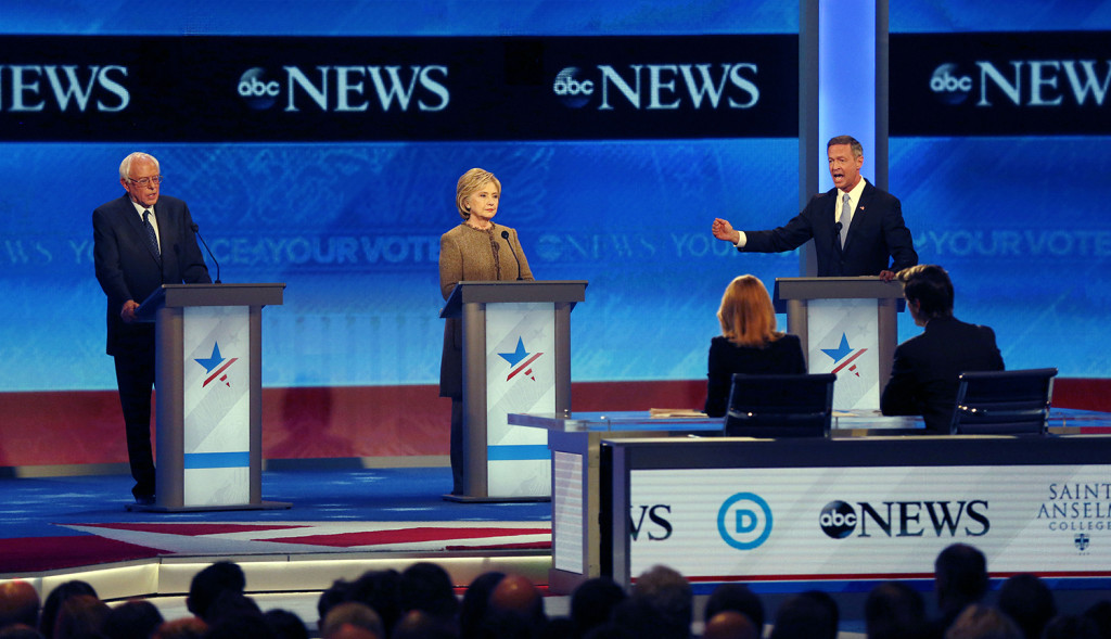 Martin O'Malley, right, speaks alongside Bernie Sanders and Hillary Clinton during a Democratic presidential primary debate Saturday at St. Anselm College in Manchester, N.H. The Associated Press