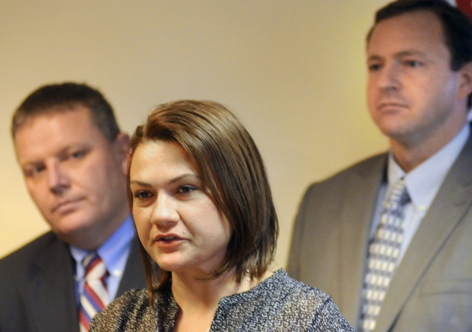 Portland resident Julie Lawson discusses her struggle with drug addiction while flanked by Senate President Mike Thibodeau, R-Winterport, left, and Speaker of the House Mark Eves, D-North Berwick, during a news conference Wednesday in Augusta. Andy Molloy/Kennebec Journal Staff Photographer