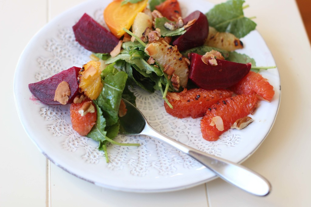 Add roasted beets and lightly charred citrus segments to nicely dressed greens for a robust salad.