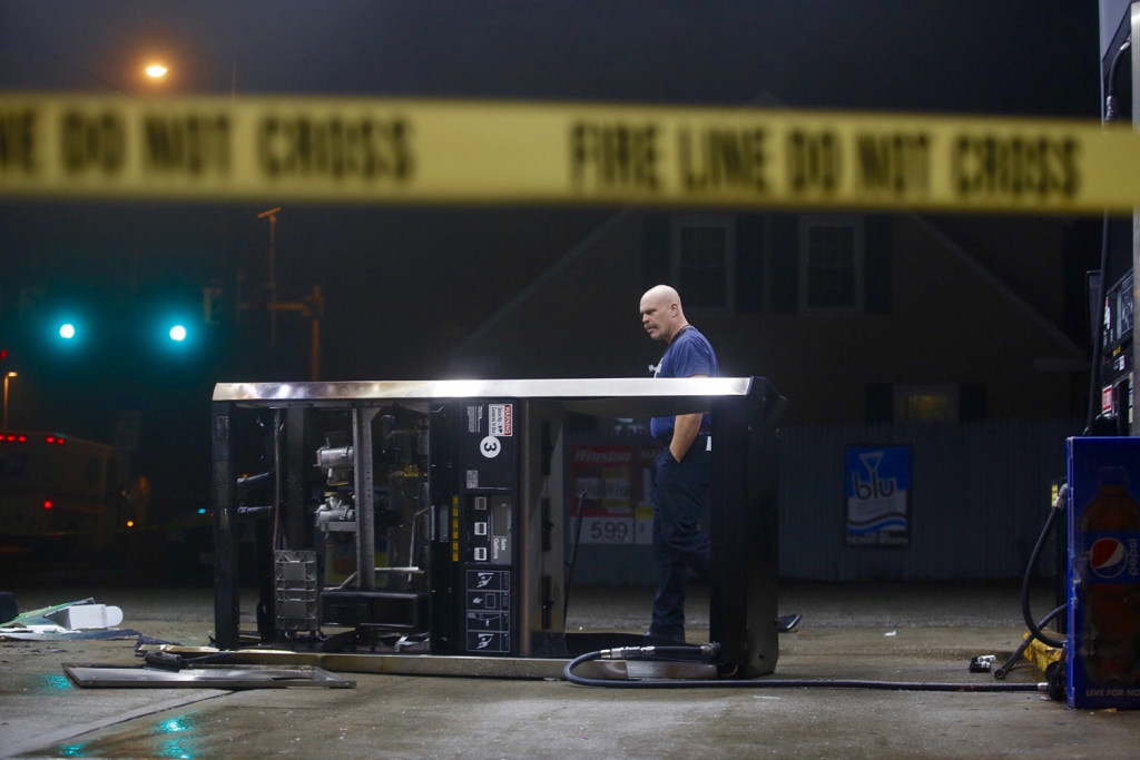 Portland Deputy Fire Chief Shawn Neat surveys the scene of an accident at a gas station on Forest Avenue on Wednesday. Derek Davis/ Staff Photographer