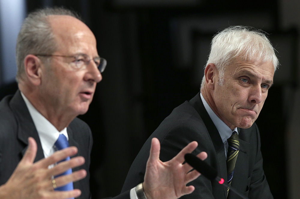 Hans Dieter Poetsch, chairman of the board of directors of  Volkswagen, left, and Matthias Mueller, CEO, address the media during a news conference  in Wolfsburg, Germany, Thursday. The Associated Press