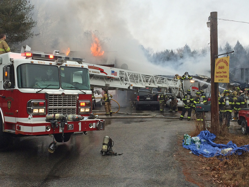 A portion of Route 302 was shut down to allow fire trucks to knock down the flames. John Ewing/Staff Photographer