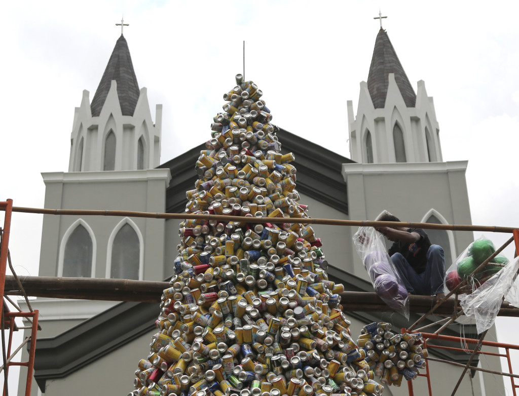 With the tree completed, the decorations are added. After Islam, Christianity is Indonesia's second-largest religion.