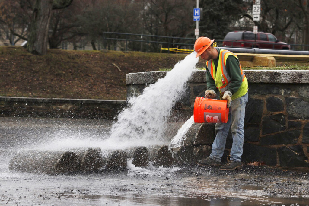 Garrett Pingree of R.J. Grondin & Sons works on repairs that are part of the renovation of the pond in Deering Oaks park in Portland on Friday.