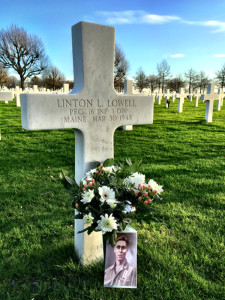 For the first time in 70 years, a likeness of Private First Class Linton Lowell of Portland sits by his grave at The Netherlands American Cemetery in Margraten, the Netherlands. A Christmas Day column in the Press Herald by Bill Nemitz connected  Jos and Monique Krick, who volunteer as caretakers for the grave, with Wayne Smith of Yarmouth, Lowell's nephew. Smith was the proud keeper of a portrait of his uncle, who died fighting the German in World War II, and emailed the Kricks a copy over the weekend.