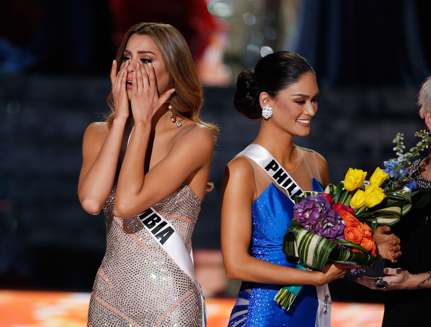 Miss Colombia Ariadna Gutierrez, left, reacts after she was named Miss Universe while standing with Miss Philippines Pia Alonzo Wurtzbach at the Miss Universe pageant Sunday in Las Vegas. Gutierrez was incorrectly crowned before Wurtzbach was named Miss Universe.
