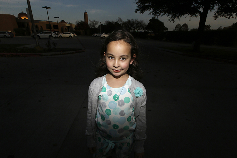 Sofia Yassini, 8, poses outside a mosque in Richardson, Texas. After seeing presidential candidate Donald Trump call on television for barring Muslims from entering the country, the 8-year-old started packing her favorite things and checking the locks on the doors because, in her mind, Donald Trump's push to ban Muslims entering the country meant the Army would come and rip her family from their home.