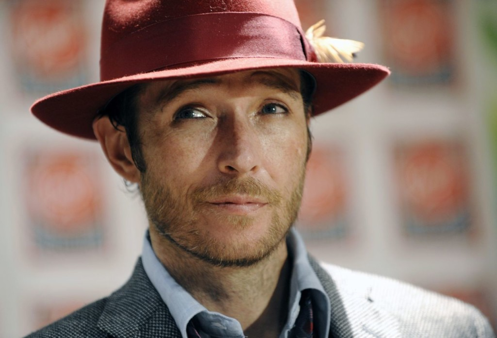 """Scott Weiland poses before signing copies of his new album, """"Happy in Galoshes"""" in this Nov. 24, 2008, photo. The Associated Press"""