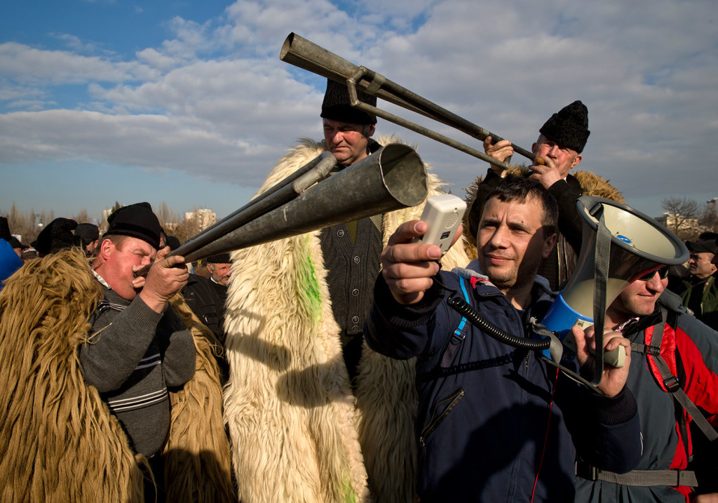 Shepherds try to amplify the sound of horns during a protest in Bucharest, Romania, on Tuesday.
