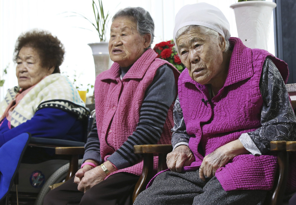 Former South Korean sex slaves, who were forced to serve for the Japanese army during World War II, wait for results of a meeting of South Korean and Japanese foreign ministers at the Nanumui Jip, The House of Sharing, in Gwangju, South Korea, Monday. Hong Ji-won/Yonhap via AP