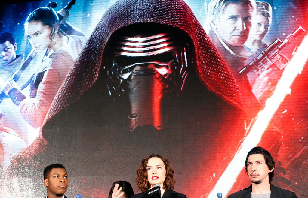 British actress Daisy Ridley, center, answers a reporter's question as British actor John Boyega, left, and U.S. actor Adam Driver listen during a press conference in Seoul, South Korea.