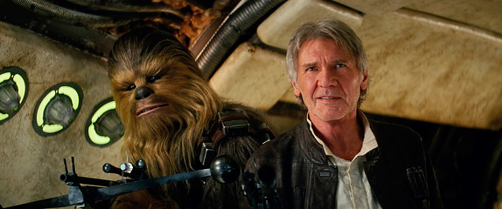"This photo provided by Lucasfilm shows Peter Mayhew as Chewbacca and Harrison Ford as Han Solo in ""Star Wars: The Force Awakens."" The movie opens in U.S. theaters on Dec. 18."