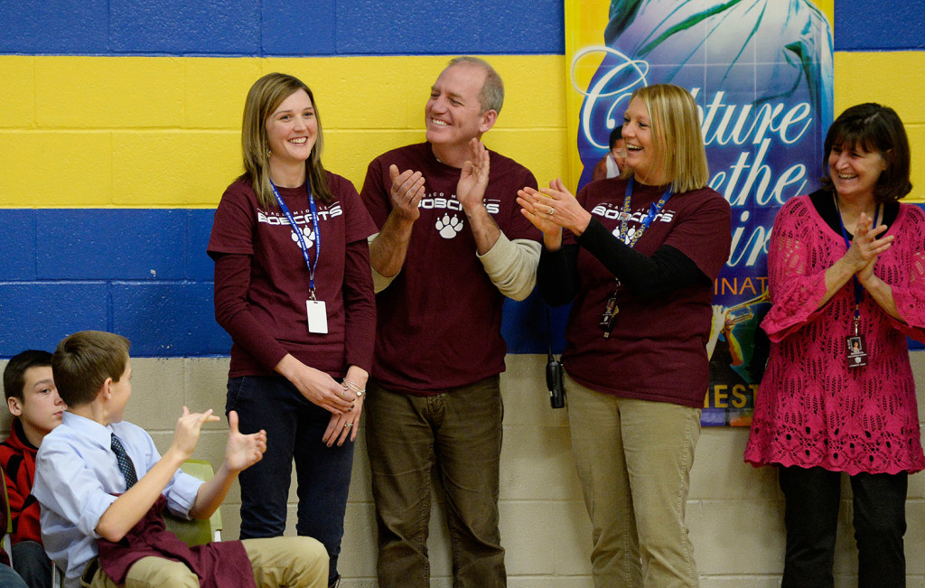 Saco Middle School eighth-grade science teacher Michaela Lamarre, left, is cheered by faculty, staff and students after it was announced that she will receive a Milken Educator Award and $25,000 on Thursday. L to R, are Lamarre, Ron Letourneau, Joan Holmes and Sandy DaGraca.