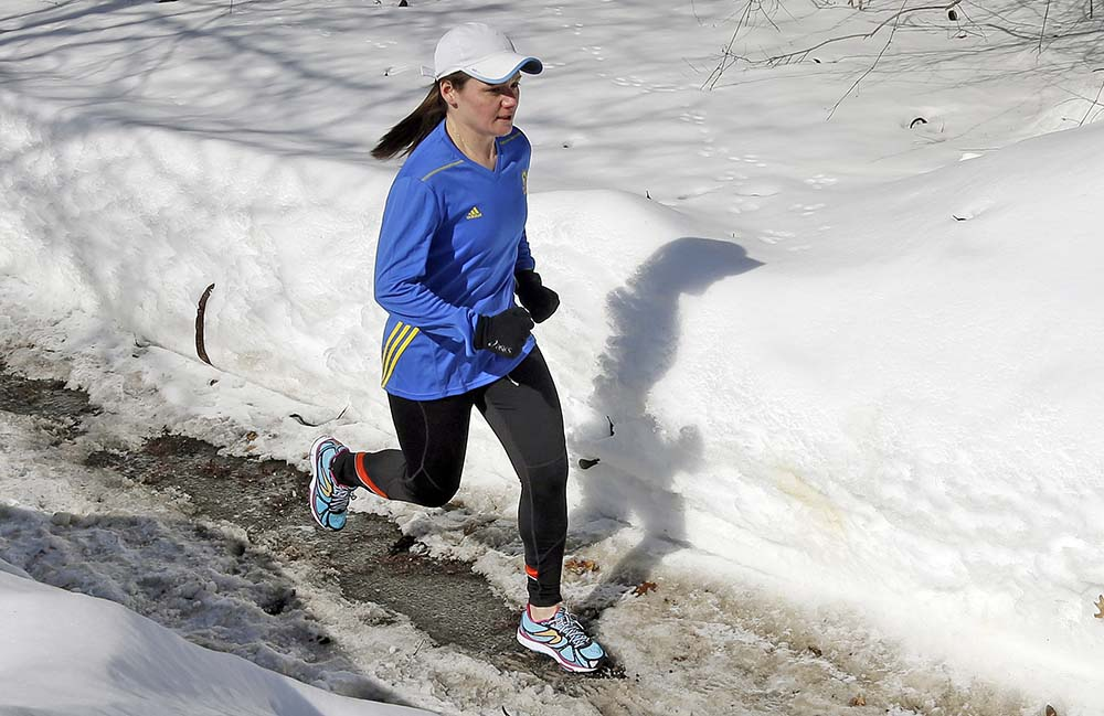 Becca Pizzi trains for the Boston Marathon along Heartbreak Hill in Newton, Mass., in this In this Feb. 27, 2015 photo. Pizzi, a veteran of 45 marathons, vies to be the first American woman to complete the World Marathon Challenge. The Associated Press