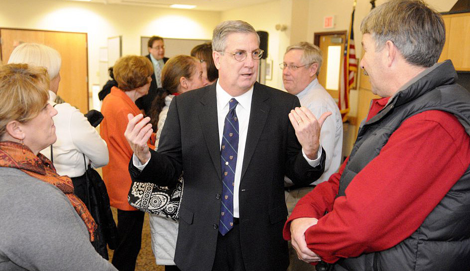 James Conneely speaks with attendees at a ceremony Tuesday announcing his appointment to the post of president of the University of Maine at  Augusta. Joe Phelan/Kennebec Journal staff photographer