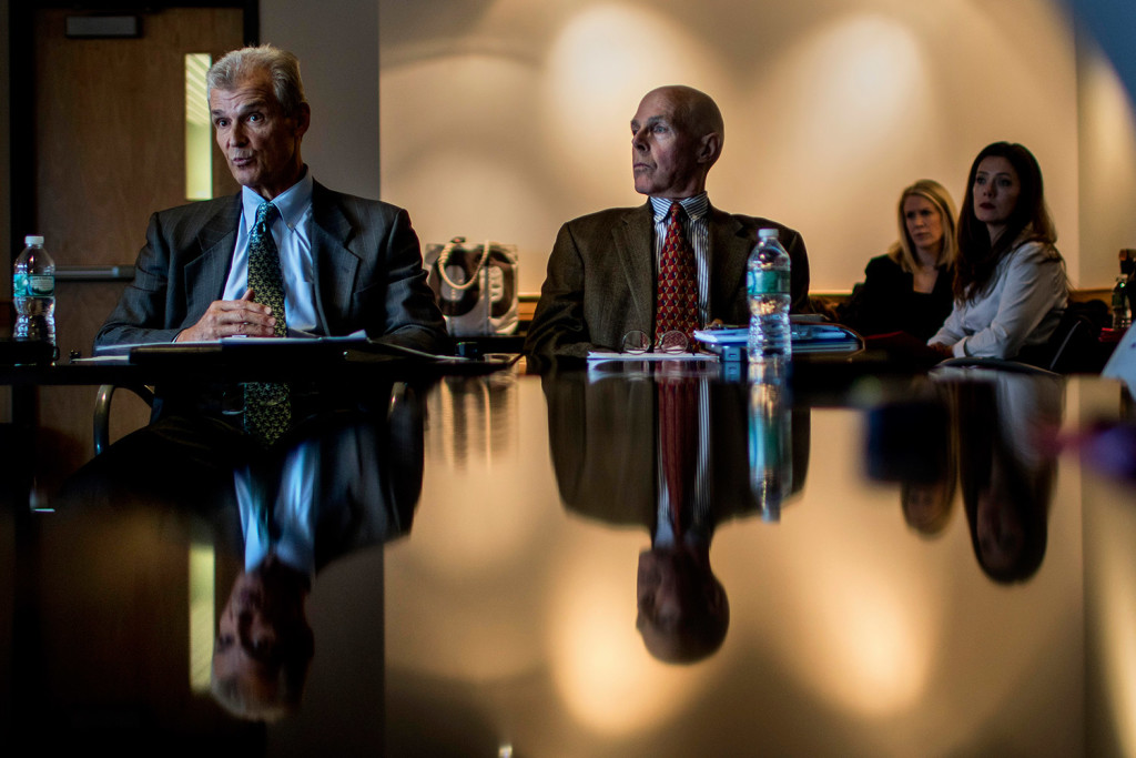 Michael Dubyak, left, former CEO of WEX, speaks at a news conference at the Gulf of Maine Research Institute in Portland on Tuesday to announce the creation of a nonpartisan think tank called FocusMaine, designed to address challenges in Maine's economic climate. At right is Charles Lawton, chief economist at Planning Decisions Inc.
