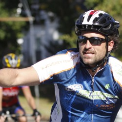 Patrick Dempsey waves a fans cheering along Elm Street in Mechanic Falls during the Dempsey Challenge in October 2011.