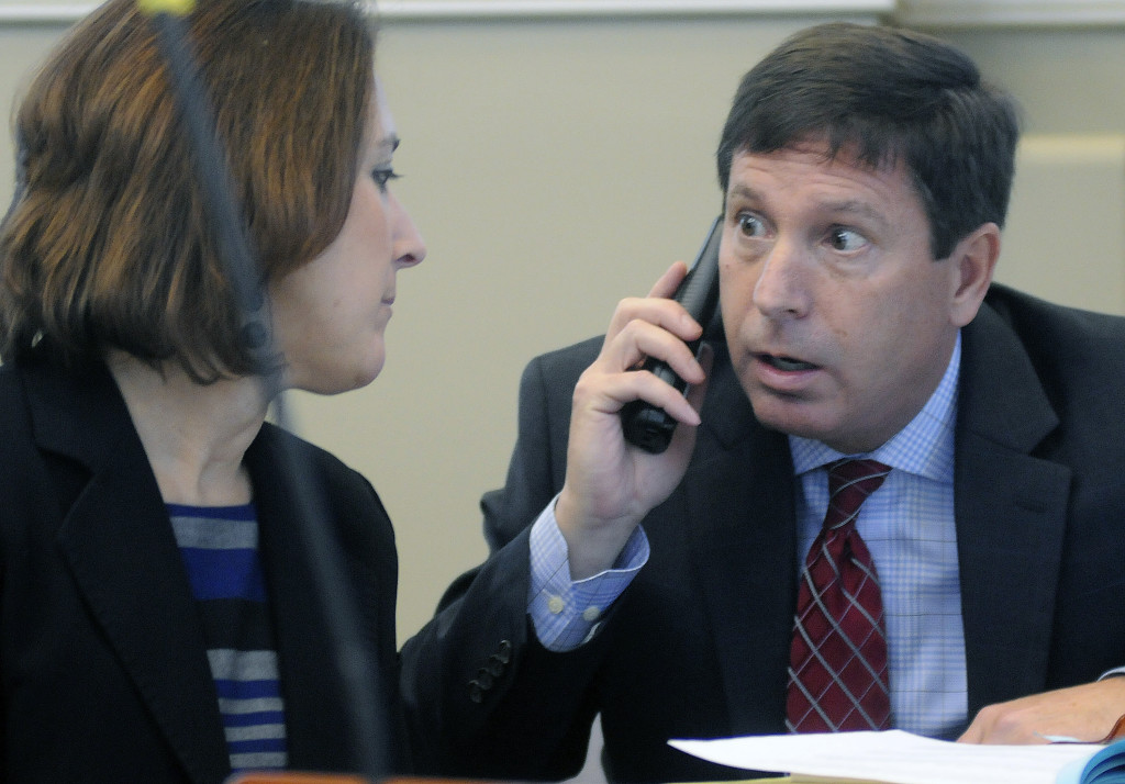 Rep. Ken Fredette, R-Newport, speaks with minority whip Rep. Ellie Espling, R-New Gloucester, during Thursday's debate in the House of Representatives to initiate impeachment proceedings against Gov. Paul LePage.  The House voted 96 to 52 to indefinitely postpone the order, killing the measure.