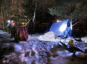 PORTLAND, MAINE - JANUARY 27, 2016: Mike Guthrie, left, shines a flashlight on a homeless encampment in Portland while looking for homeless people during the annual point-in-time homeless count on Wednesday, January 27, 2016. Guthrie did not find anyone present at the campsite. (Photo by Gregory Rec/Staff Photographer)