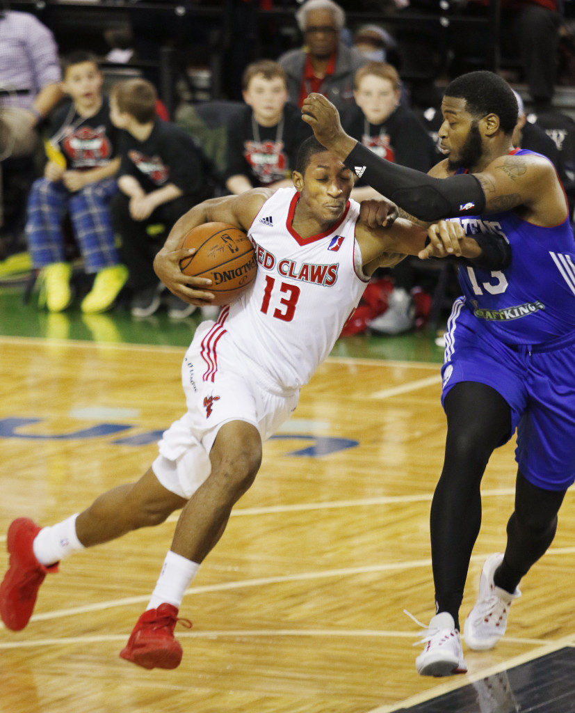Maine's Malcolm Miller, left, drives for the basket while being guarded by Delaware's David Laury III during the Red Claws' 118-112 loss Sunday at the Portland Expo which snapped a five-game winning streak. Joel Page/Staff Photographer