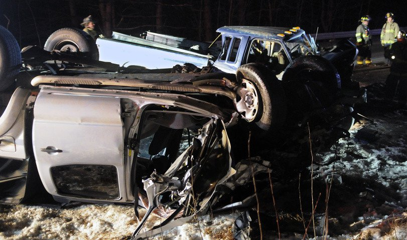 Firefighters check pickup trucks that collided on Route 9 in Chelsea, injuring three people Monday evening. All the victims had to be extricated from the vehicles, police said, to be treated for multiple, life threatening injuries. Andy Molloy/Staff Photographer