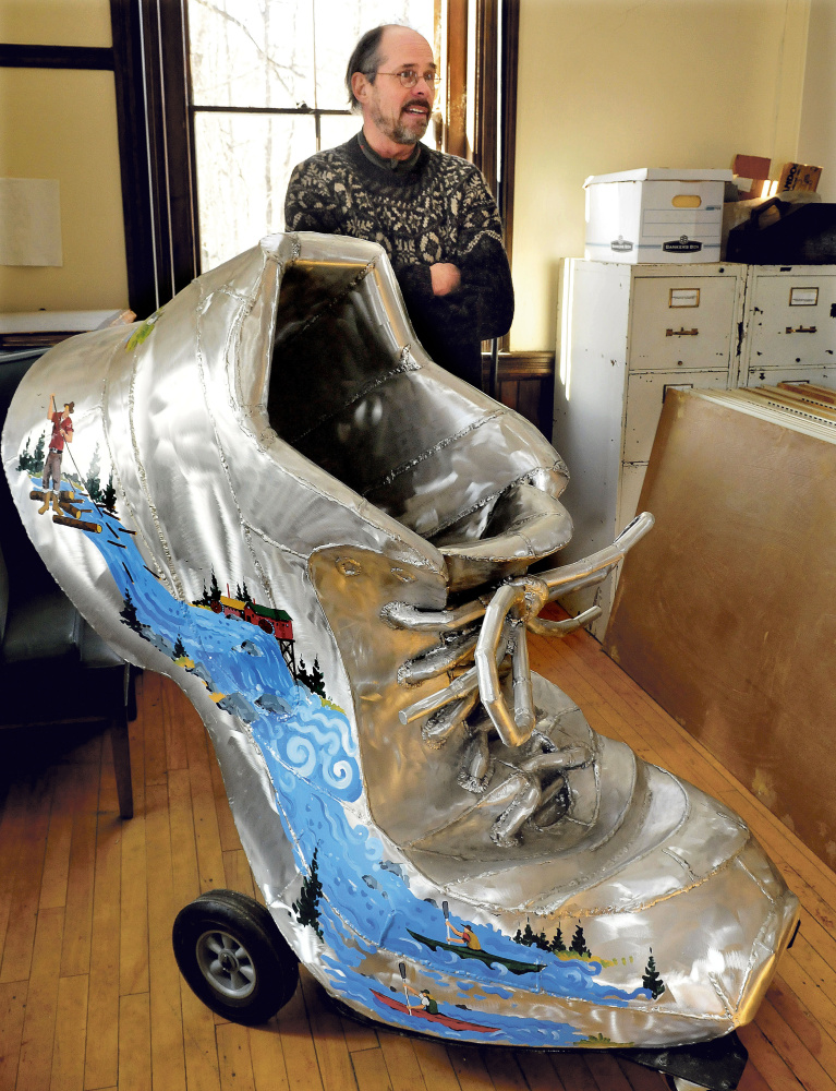Steve Dionne on Wednesday speaks about the effort to put the town's giant shoe sculpture in downtown Skowhegan after it's been in storage. The artwork commemorates the town's shoe industry and youth fitness.