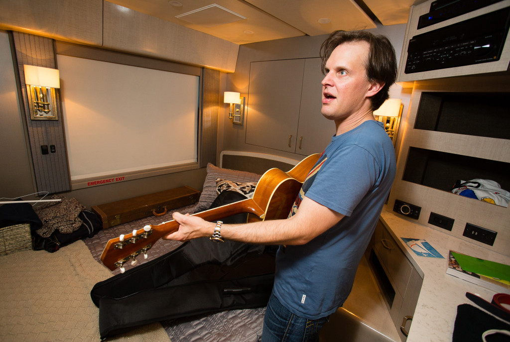 Joe Bonamassa fiddles with a guitar from his collection, a 1966 Gibson Trini Lopez, during his visit to Bangor last summer. Photo for The Washington Post by Carl D. Walsh