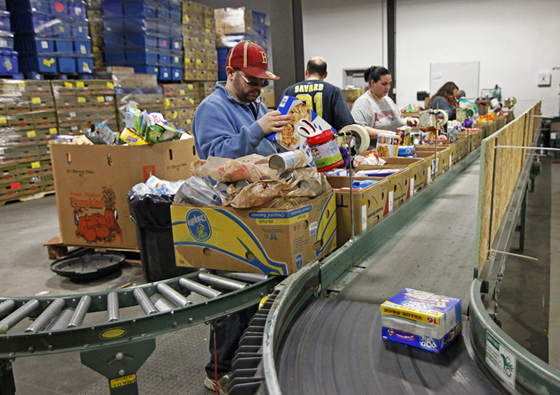 Food from retailers such as Walmart and Hannaford is inspected before being sent to sorting, and then eventually into categories for inventory at the Good Shepherd Food Bank headquarters in Auburn. Jill Brady/Staff Photographer