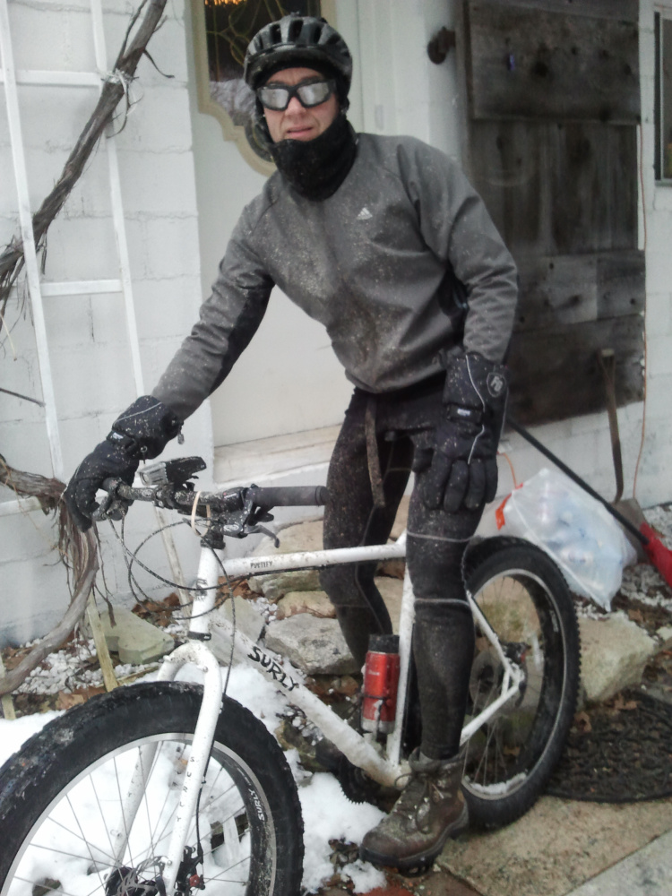 Brian Edwards of Raymond commutes to work by bike year-round. In winter he makes the  25-mile round-trip ride on bikes with fat, studded tires. Kelly Edwards photo