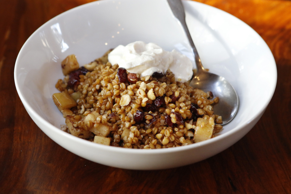 Warm farro breakfast bowl with apples, cranberries and hazelnuts Joel ...