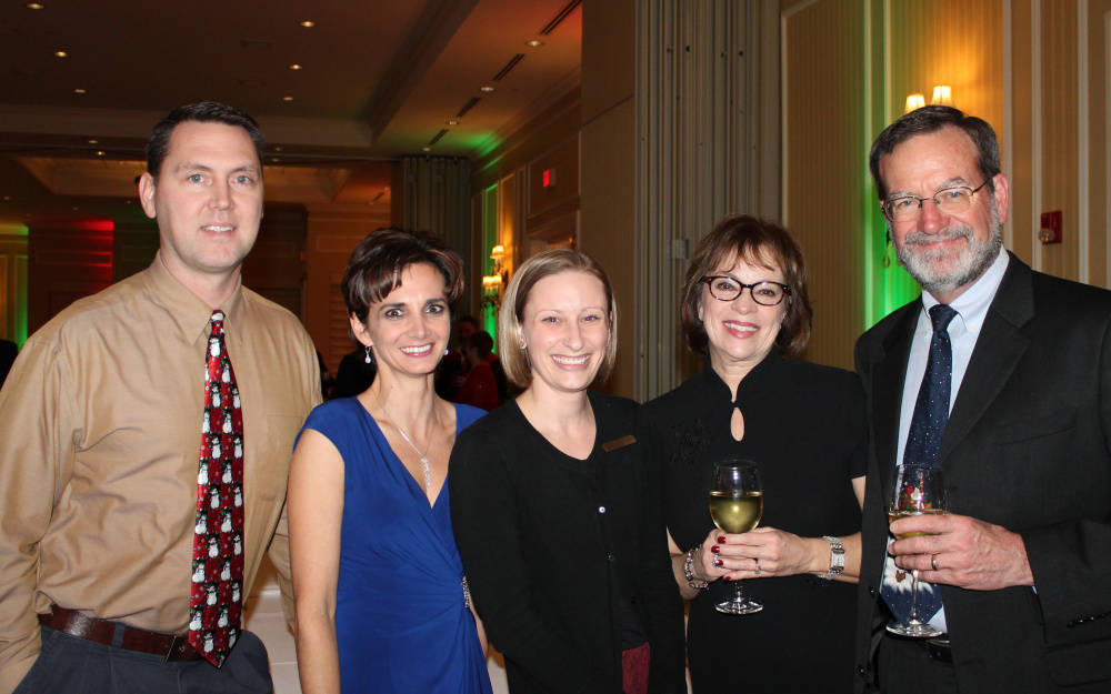 James Beardsley, left, attorney with Lowry & Associates, joins colleagues Karen Hanna and Michael Vaughn, with his wife, Diane Vaughn; and Brooke Kreider, center, event manager at Marriott Sable Oaks.