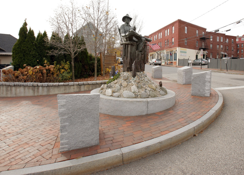 A reader notes that a tribute to John Ford, displayed at Gorham's Corner alongside this statue of the director, is one of several public monuments in Portland whose wording includes errors.
